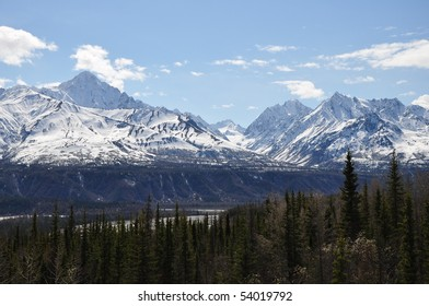 Alaskan landscape with mountains and forest