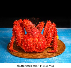 Alaskan Red King Crab on vintage blue wooden background,Cooked Organic Taraba King Crab with Butter and lemons
