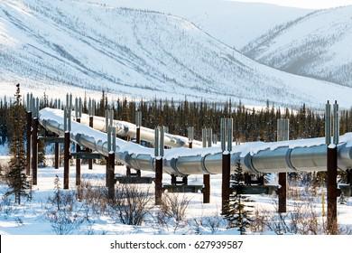 alaska's brooks mountain range snow-covered in winter with trans-alaska pipeline traversing