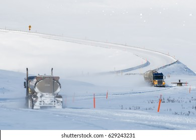 alaska's dalton highway winding up to the atigun pass in winter