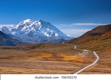 alaska's mount denali on a clear blue sky day, as seen from denali national park road looking to the west