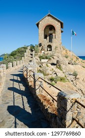 ALASSIO, ITALY. 22nd October 2018. The Cappelletta, a tiny stonebuilt place of worship, overlooking the waves at Alassio, Province of Savona, Italy. The resort is attractive even in the off-season.