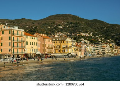 Alassio, Liguria / Italy - 01 02 2019: Scenic view of the sandy beach with tourists in a sunny winter day
