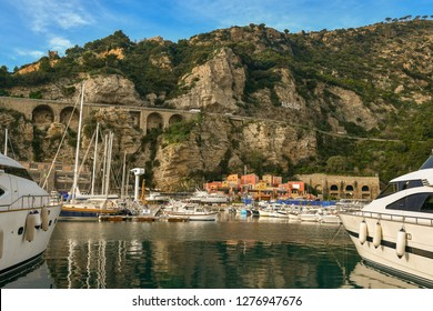 Alassio, Liguria / Italy - 12 30 2018: Scenic view of the harbor with moored boats and cliff