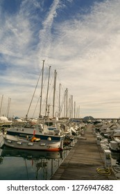 Alassio, Liguria / Italy - 12 30 2018: Boats moored at a wharf in a harbor
