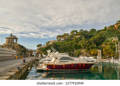 Alassio, Liguria / Italy - 12 30 2018: View of the harbor with  docked boats and the Cappelletta (little chapel) on the left