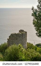 Alassio, Liguria / Italy - 12 31 2018: Ruin of the Saracen Tower on the cape of Santa Croce, Alassio, Liguria, Italy