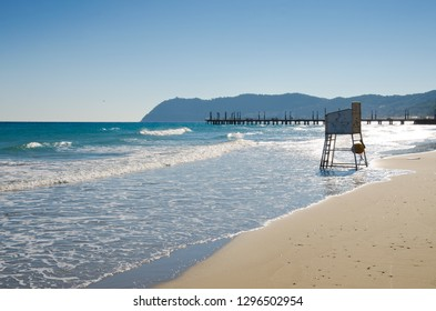 ALASSIO, LIGURIA, ITALY. 22nd October 2018. An empty lifeguard's chair overlooking the waves on the empty beach at Alassio, Liguria, Italy. The resort is attractive to tourists even in the off-season.