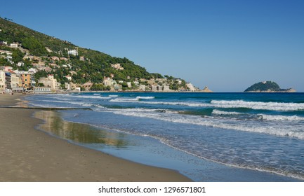 ALASSIO, LIGURIA, ITALY. 22nd October 2018. Looking out at the waves on the empty beach at Alassio, Liguria, Italy. The resort is attractive to tourists even in the off-season.