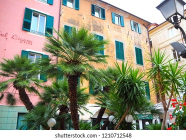 ALASSIO (SAVONA), ITALY - SEPTEMBER 2017: Colorful facades of famous resort Alassio (province of Savona) on the Italian Riviera in Western Liguria, Italy