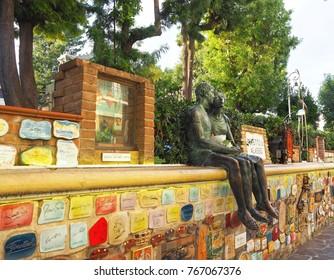 "Alassio (Savona), ITALY - SEPTEMBER, 2017: ""Muretto di Alassio"",  famous Wall in Alassio with bronze statue of the lovers."