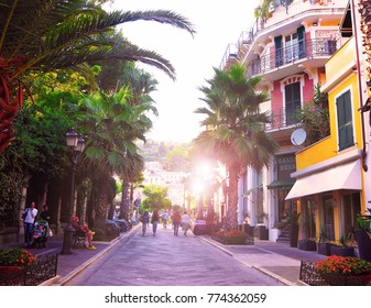 ALASSIO, SAVONA, ITALY-SEPTEMBER 2017:Promenade in city center, beautiful old street in tourist town of Alassio on  Italian Riviera San Remo, west of Liguria, Cote d'Azur, Italy