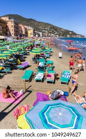 Alassio (SV), ITALY - August 21, 2017: Beach at Alassio (ITALY) with people sunbathing, swimming and relaxing on a warm summer day.