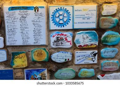 "Alassio (SV), Italy - February 15, 2017: Ceramic icons with celebrities signature at the famous ""Muretto"" in Alassio town, Riviera dei Fiori, Savona, Liguria, Italy."