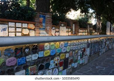 """Alassio (SV), Italy - February 15, 2017: The famous """"Muretto"""" in Alassio town, Riviera dei Fiori, Savona, Liguria, Italy."""