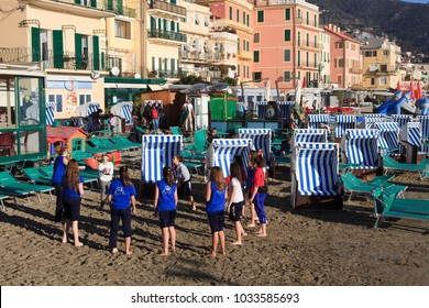 Alassio (SV), Italy - February 15, 2017: Childrens playing in beach in Alassio, Riviera dei Fiori, Savona, Liguria, Italy.