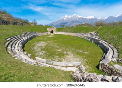 Alba Fucens (Italy) - An evocative Roman archaeological site with amphitheater, in a public park in front of Monte Velino mountain with snow, Abruzzo region, central Italy