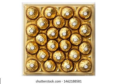 ALBA, ITALY - 22 JUNE 2019: Ferrero Rocher premium chocolate sweets produced by the Italian chocolatier Ferrero. The brand is sold in over 40 countries worldwide. Editorial,