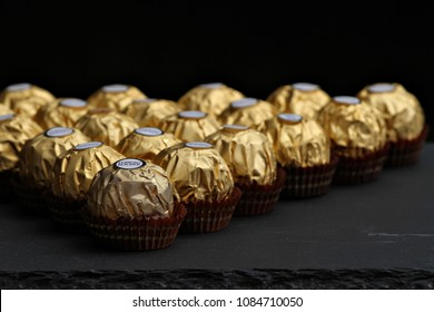 ALBA, ITALY - 6 MAY 2018: Ferrero Rocher chocolate and hazelnut confectionery balls on a table. Roughly 3.6 billion Ferrero Rochers are sold each year in over 40 countries worldwide. Editorial.