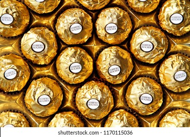 ALBA, ITALY - 9 JULY 2018: A tray of Ferrero Rocher chocolate and hazelnut confectionery pralines. Roughly 3.6 billion Ferrero Rochers are sold each year in over 40 countries worldwide. Editorial.