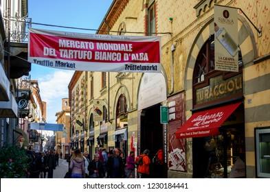 ALBA, ITALY – NOVEMBER 15, 2018: People entering the truffle market of the International Truffle Fair of Alba (Piedmont, Italy), main truffle event in all Italy, on November 15, 2018.