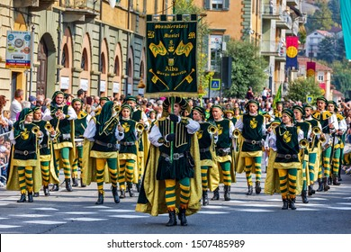 ALBA, ITALY - OCTOBER 01, 2017: Procession in historic dresses on Medieval Parade - traditional part of celebrations during annual White Truffle festival taking place each year in Alba, Italy.