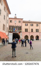Alba, Italy - October 1, 2018: Tourists by the beautiful City Hall in the historic city of Alba in Piedmont in Italy