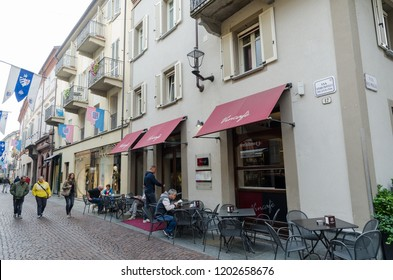 Alba, Italy - October 1, 2018: Street café in the historic city of Alba in Piedmont in Italy