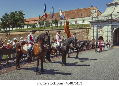 Alba Iulia, Romania - July 24, 2016: Tourists watch the changing of guards, a unique military ceremony in Transylvania, at the third gate of Alba Carolina Citadel.