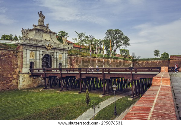 ALBA IULIA, ROMANIA - MAY 6, 2015: Unidentified people visit the Third Gate of the White Carolina Citadel, the largest gate of the seven baroque gates of the fortification.