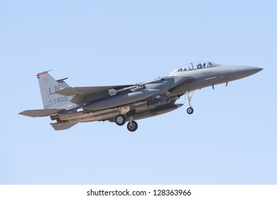 ALBACETE,SPAIN - APRIL 11: Military fighter jet during demonstration in Albacete air base, Los Llanos, Aerobatic Spanish patrol perform at an airshow (TLP) on April 11, 2012 in Albacete,Spain