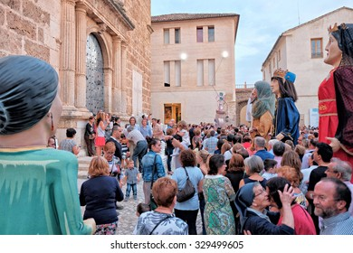 Albaida, Spain - October 04, 2015: A lot of village people are in the Church Square during the traditional festivities with carnival figures of Giants and Big Heads from Albaida City, Spain.