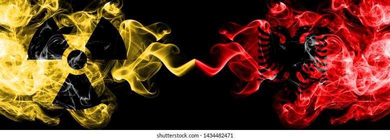 Albania, Albanian vs nuclear smoky mystic flags placed side by side. Thick colored silky smokes combination of Albania, Albanian flag and radioactive sign.