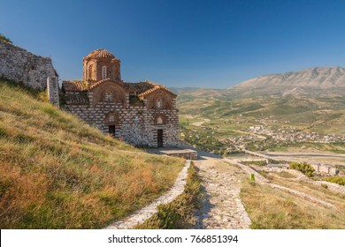 Albania - Berat - Ancient stone orthodox St Trinity church on the hill of old Berat castle with valley behind