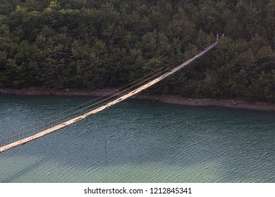 Albania: Decaying Hanging or suspension bridge with loose wires and broken wooden planks