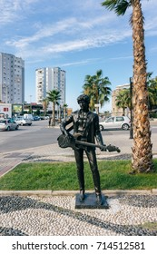 ALBANIA, DURRES - September 22, 2015: Sculpture of Bob Dylan on the embankment near the palm tree