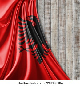 Albania flag and wood background