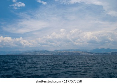Albanian coast, Ionian sea and sky. View from village Kassiopi, Corfu Island, Greece