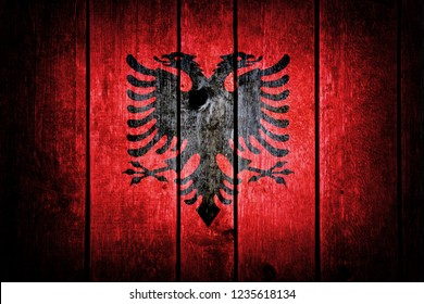 Albanian flag on a wooden background