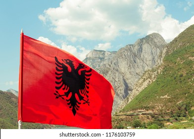 albanian flag waving in the koman river. Edited to look like an old painting just like the old Albanian tradition.