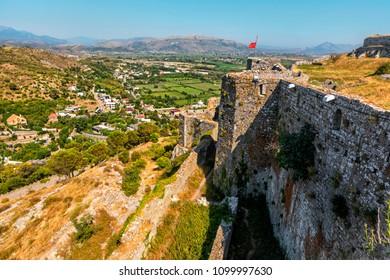 Albanian red flag and Ruins of Rozafa Castle, Shkoder, Albania.