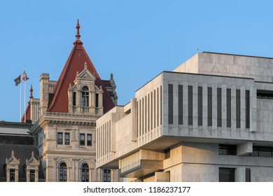 ALBANY, NEW YORK, USA - AUGUST 6, 2018: New York State Capitol building contrasts with more contemporary office building at State Street and Washington Avenue in Albany