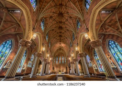 ALBANY, NEW YORK, USA - AUGUST 6, 2018: Stained glass windows and ceiling inside the historic Cathedral of the Immaculate Conception on Eagle Street in Albany