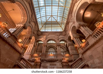 "ALBANY, NEW YORK, USA - AUGUST 6, 2018: The Great Western Staircase (or ""Million Dollar Staircase"") and atrium inside the New York State Capitol building in Albany"