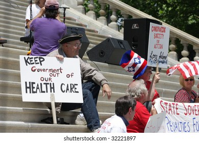 """ALBANY, NY - JUNE 16: Protesters against wasteful government spending and corrupt career politicians sits during the Tea Party Patriots """"March on Albany"""" protest on June 16, 2009 in Albany NY"""