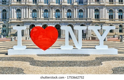 Albany, NY, USA - September 7, 2019: I love NY symbols in front of The New York State Capitol. The New York State Capitol, the seat of the New York State government