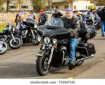 Albany, Oregon - 11/11/2017: Motorcycles and riders in the Veetran's Day parade, decorated with flags and statements in support of veterans.