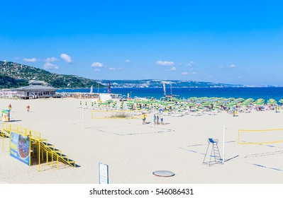 ALBENA, BULGARIA - JULY 12, 2016.The Black Sea shore, blue clear water, beach with sand, umbrellas and sunbeds. Albena, Bulgaria