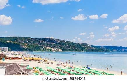 ALBENA, BULGARIA - JULY 21, 2016. The Black Sea shore, blue clear water, beach with sand, umbrellas and sunbeds. Albena, Bulgaria