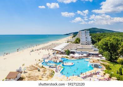 ALBENA, BULGARIA - JULY 21, 2016. The Black Sea shore, blue clear water, beach with sand, umbrellas and sunbeds. Albena, Bulgaria